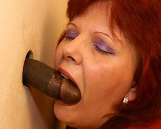 This mature slut loves a cock on the gloryhole toilet