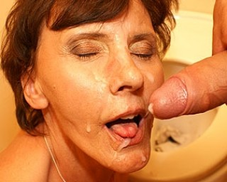 Give this mature slut a cock through the hole
