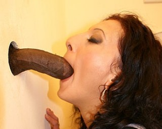MILF fucked and pissed through the gloryhole