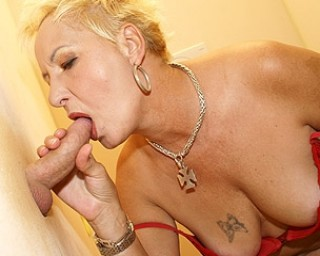 Mature mature-gloryhole She just loves whats cumming through the gloryhole