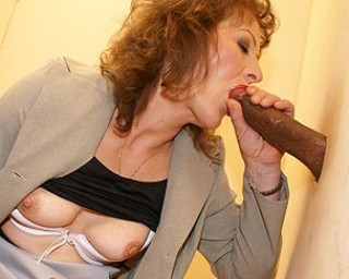 Mommy loves that black cock peeping through the hole